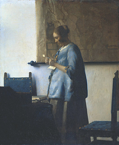 woman_in_blue_reading_a_letter